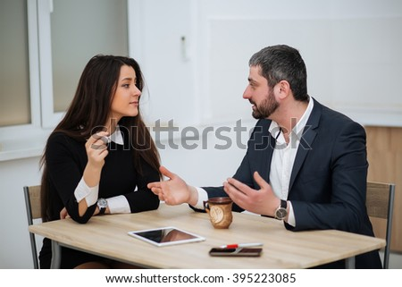 Businessman talking to a woman for a job, interviewing - stock photo