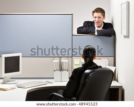 Businessman talking to co-worker - stock photo