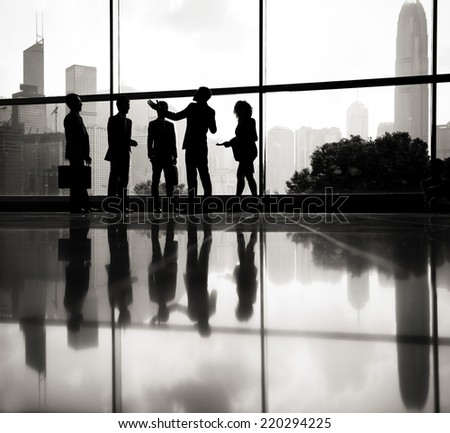 Businessman talking to his co-workers. - stock photo