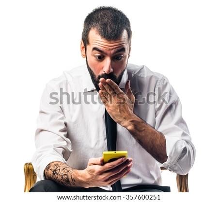 Businessman talking to mobile - stock photo