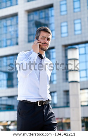 Businessman talking to the cell phone