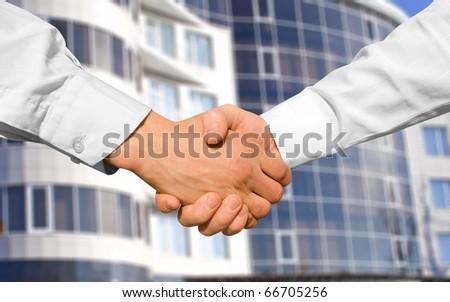 Businessman teamwork partners shaking hands - stock photo