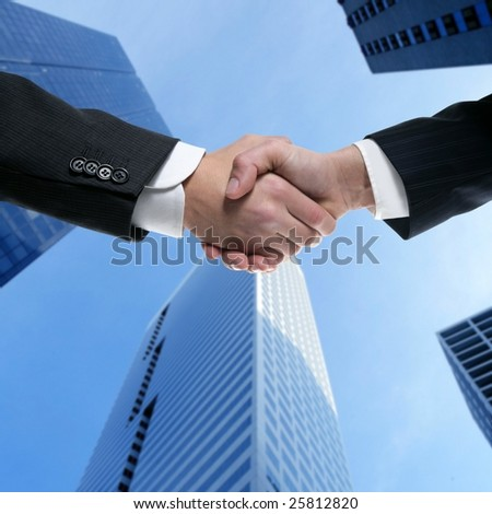 Businessman teamwork partners shaking hands with suit [Photo Illustration]
