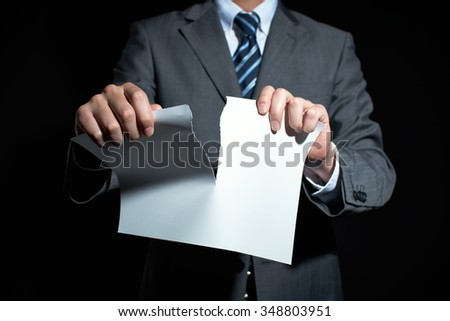 Businessman tear paper concept for breaking contract - stock photo