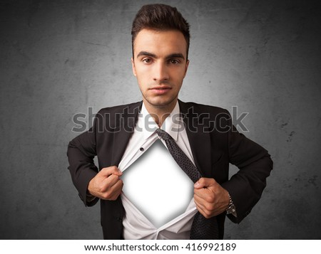 Businessman tearing off his shirt with white copyspace on chest on grungy background - stock photo