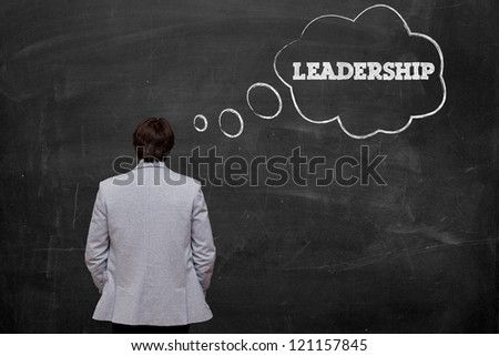 businessman think about leadership at chalkboard - stock photo