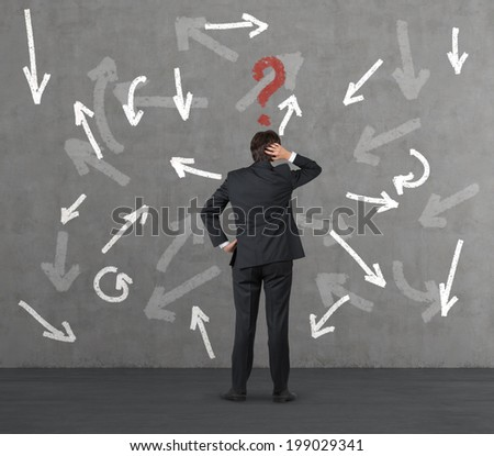 Businessman thinking about the route - stock photo
