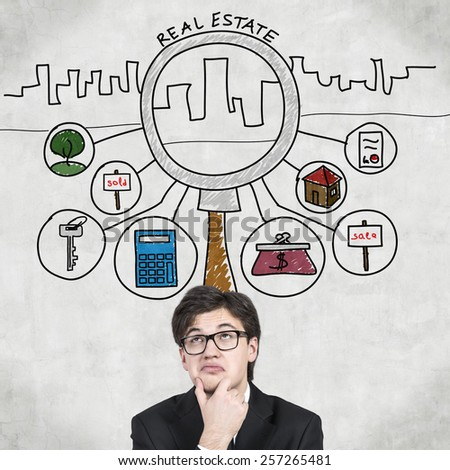 businessman thinking and drawing real estate symbol over head - stock photo