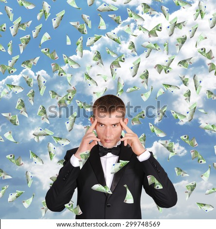 businessman thinking and flying 100 euro bills - stock photo