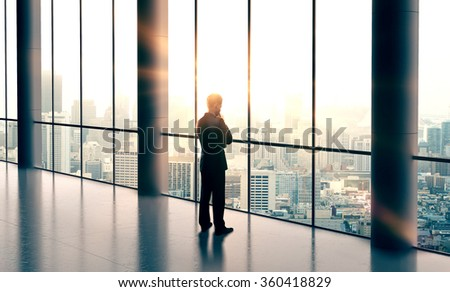 businessman thinking and looking in city - stock photo