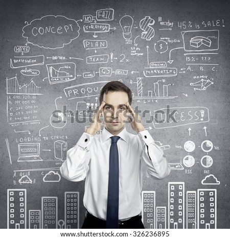 businessman thinking and  wall  with business strategy - stock photo