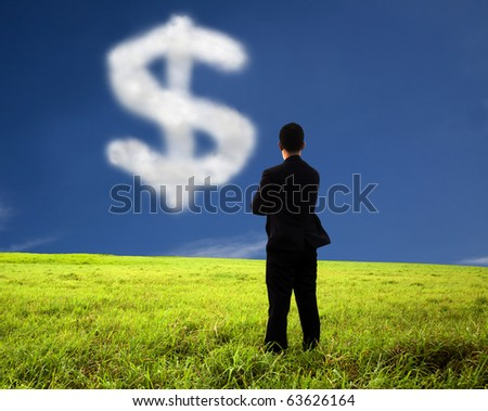 businessman thinking and watching the money mark of cloud - stock photo