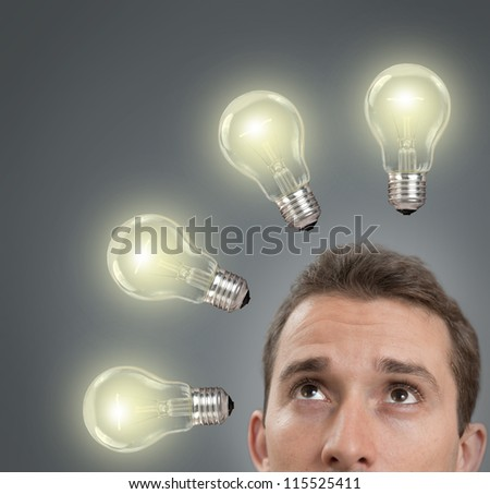 Businessman thinking concept with a light bulbs on - stock photo