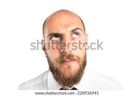 Businessman thinking, looking up - stock photo