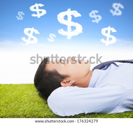 businessman  thinking money and goal on a meadow - stock photo