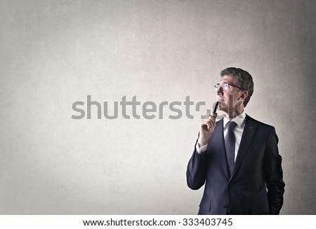 Businessman thinking of something - stock photo