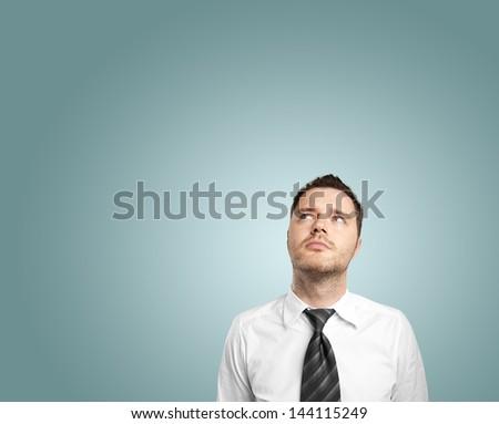 businessman thinking on blue background - stock photo