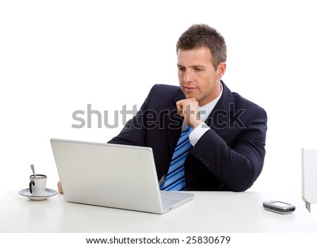 Businessman thinking over his laptop computer, looking seriously at screen. - stock photo