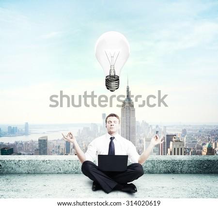 businessman thinking sitting on roof - stock photo