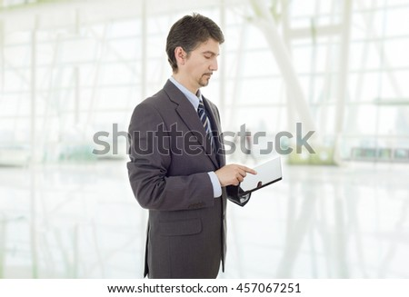 businessman thinking with a tablet pc, at the office - stock photo