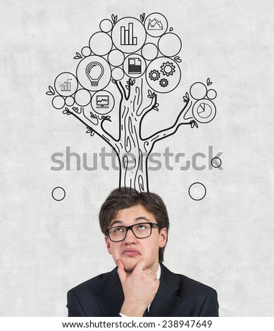 businessman thinking with business tree over head - stock photo