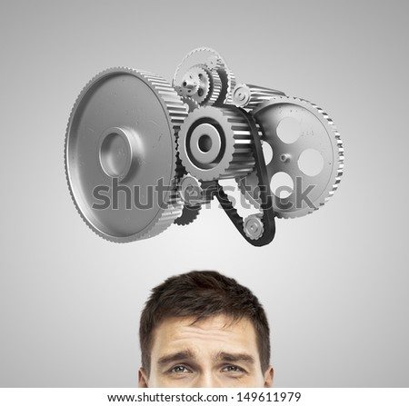 businessman thinking with gears over head