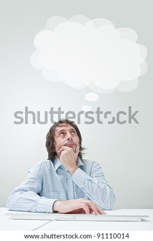 Businessman thinking with his head in the clouds