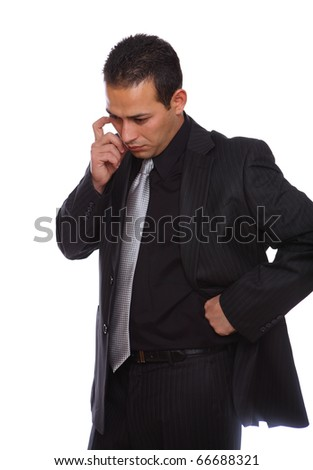 Businessman thinking with suit on and isolated on white - stock photo
