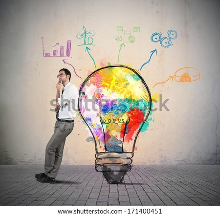 Businessman thinks of a new creative idea - stock photo
