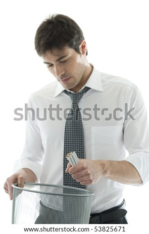 Businessman throwing cigarettes. Concept: give up smoking.