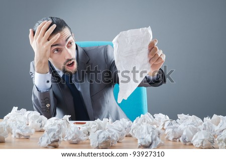 Businessman throwing paper away - stock photo