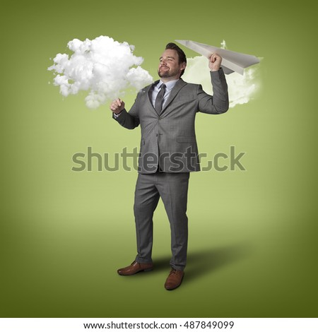 Businessman throwing paper plane with cloud