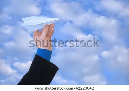 businessman throwing white paper plane - stock photo