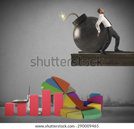 Businessman throws bomb on graphs and statistics - stock photo