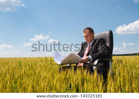 businessman throws up his papers
