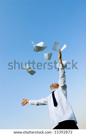 businessman throws up his papers - stock photo