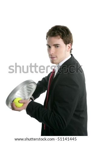 businessman tie suit holding paddle tennis racket and ball - stock photo