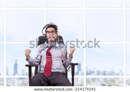 Businessman tied in rope at office with cityscape - stock photo