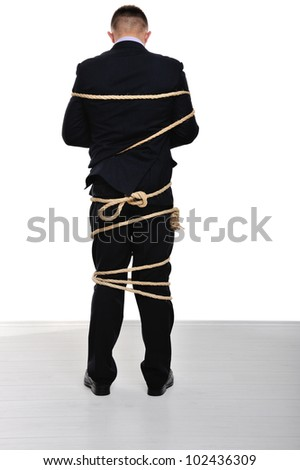 Businessman tied up on white background - stock photo
