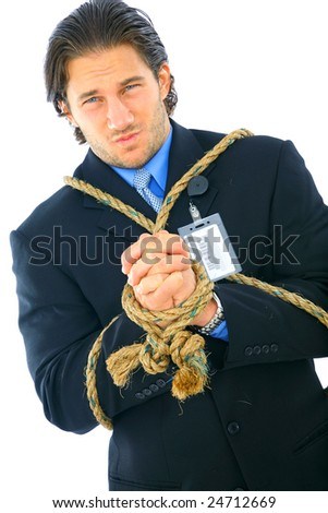 businessman tied up with rope showing angry expression. concept for bankruptcy, credit crisis, or debt - stock photo