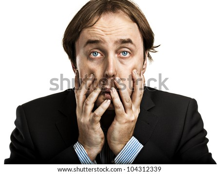 Businessman tired from crisis and working with hands over face - stock photo