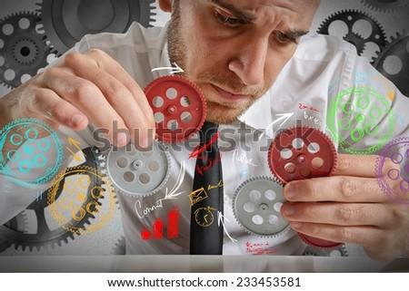 Businessman to build a system with gears - stock photo