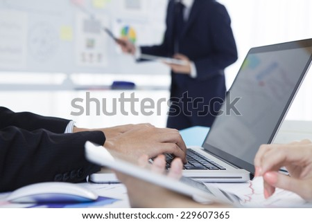 Businessman to operate a laptop - stock photo