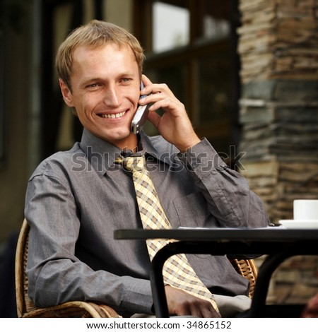 businessman to speak on telephone - stock photo