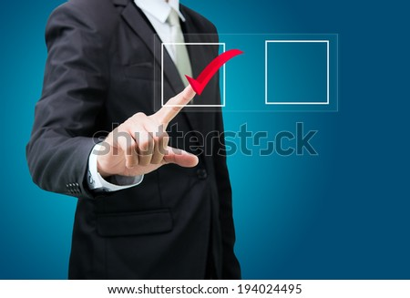 businessman touch checking mark checklist marker Isolated on blue background - stock photo