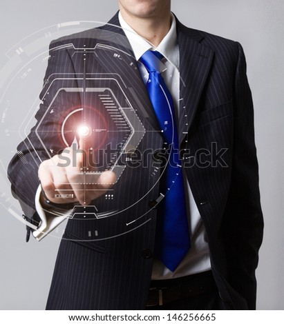 Businessman touch digital virtual screen - stock photo