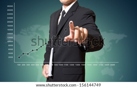 businessman touch graph improve suggest more - stock photo