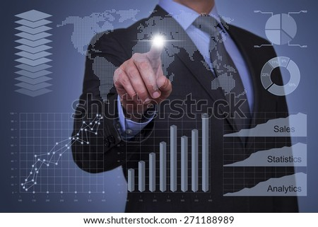 Businessman Touch Graph with Finger - stock photo
