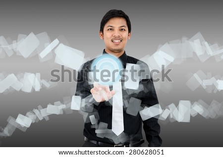 Businessman touch navigating on virtual interface - stock photo