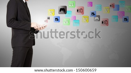 businessman touch phone have application in air - stock photo
